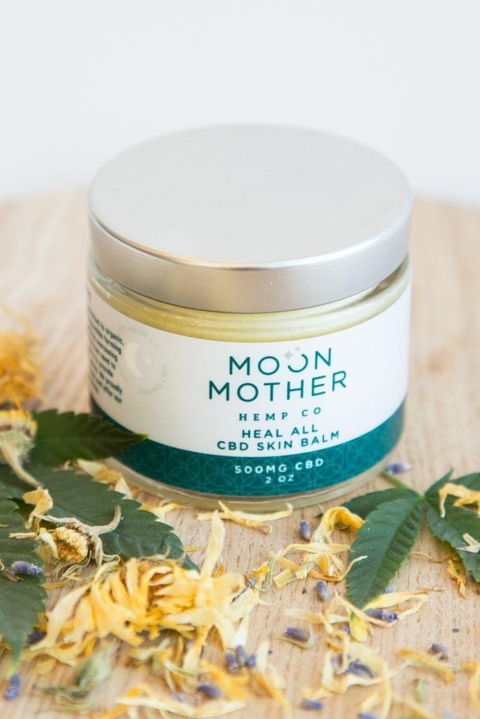 CBD Heal All Skin Balm among herbs